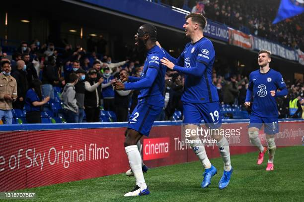 Antonio Ruediger of Chelsea celebrates after scoring their sides first goal with team mate Mason Mount during the Premier League match between...