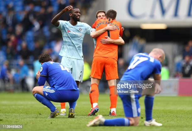 Antonio Ruediger of Chelsea Cesar Azpilicueta of Chelsea and Kepa Arrizabalaga of Chelsea celebrate at the final whistle as Sean Morrison of Cardiff...