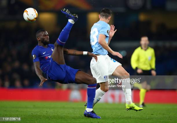 Antonio Ruediger of Chelsea clears the ball from Marcus Antonsson of Malmo during the UEFA Europa League Round of 32 Second Leg match between Chelsea...