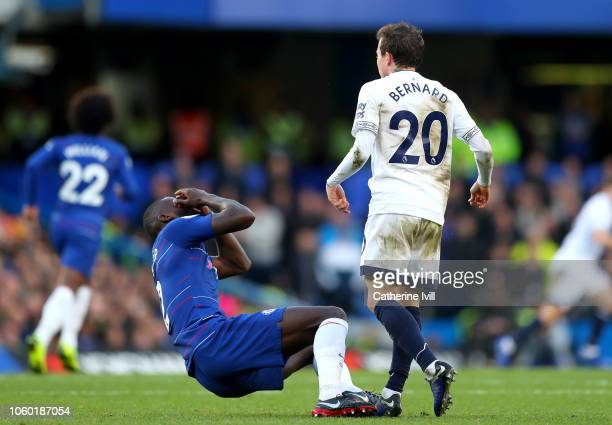 Antonio Ruediger of Chelsea clutches his face after a clash with Bernard of Everton during the Premier League match between Chelsea FC and Everton FC...