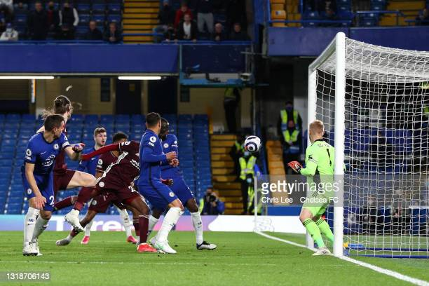 Antonio Ruediger of Chelsea scores their sides first goal past Kasper Schmeichel of Leicester City during the Premier League match between Chelsea...