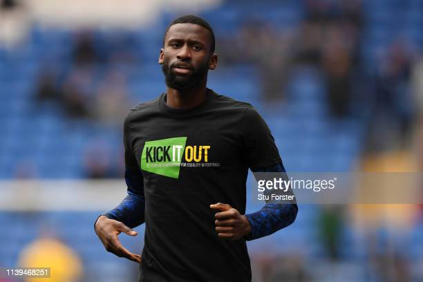 Antonio Ruediger of Chelsea warms up while wearing the kick it out t shirt ahead of the Premier League match between Cardiff City and Chelsea FC at...