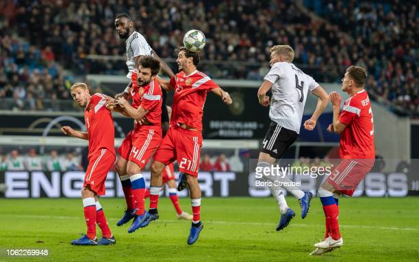 Antonio Ruediger of Germany and Matthias Ginter of Germany jump for a header during the International Friendly match between Germany and Russia at...