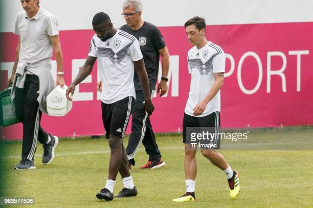 Antonio Ruediger of Germany and Mesut Oezil of Germany look on during day seven of the Southern Tyrol Training Camp on May 29 2018 in Eppan Italy