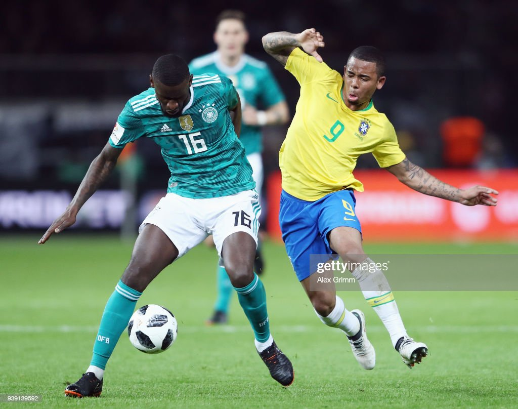 Antonio Ruediger (L) of Germany is challenged by Gabriel Jesus of Brazil during the international friendly match between Germany and Brazil at Olympiastadion on March 27, 2018 in Berlin, Germany.