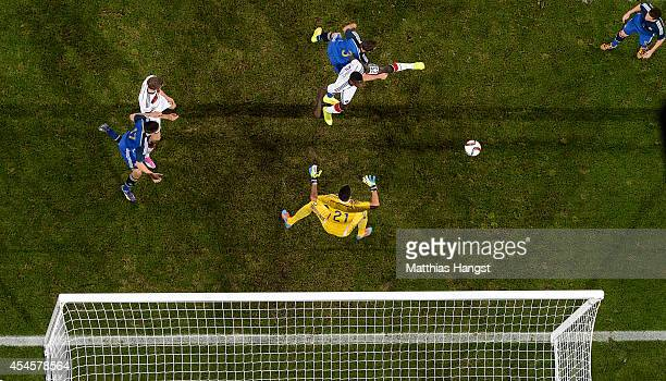 Antonio Ruediger of Germany jumps for a header with Hugo Campagnaro of Argentina during the international friendly match between Germany and...