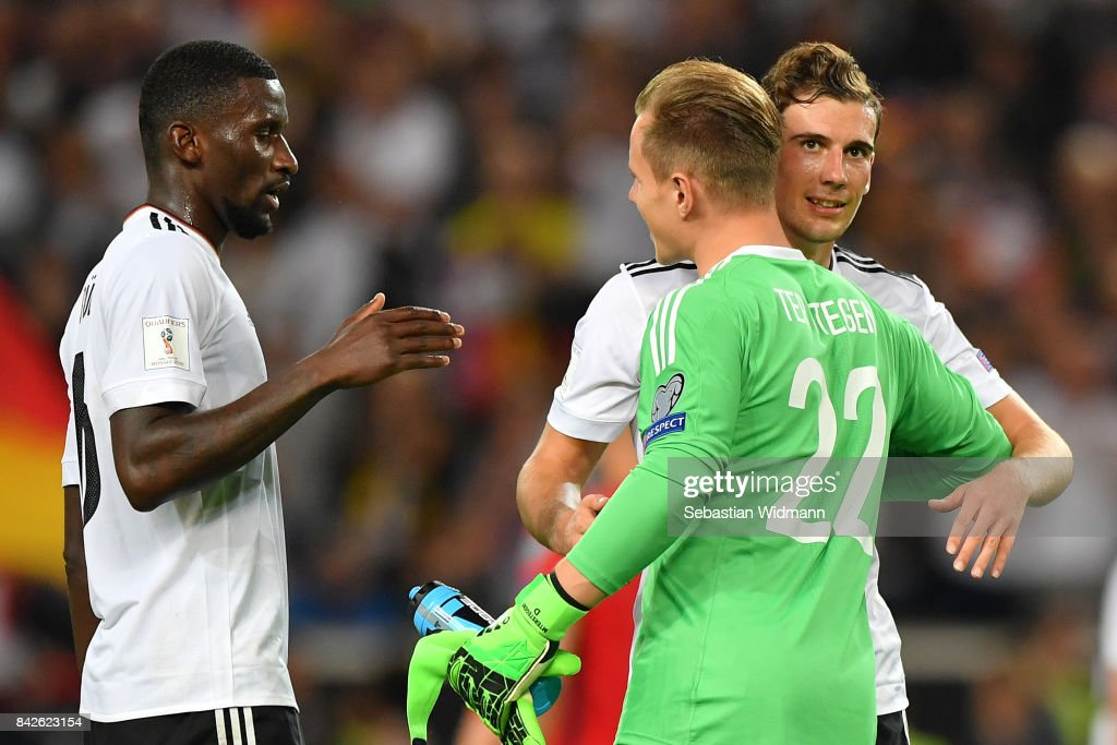 Antonio Ruediger of Germany (l) Marc-Andre ter Stegen of Germany and Leon Goretzka of Germany embrace after the FIFA 2018 World Cup Qualifier between Germany and Norway at Mercedes-Benz Arena on September 4, 2017 in Stuttgart, Baden-Wuerttemberg.