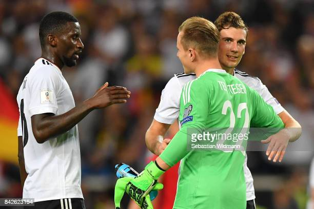 Antonio Ruediger of Germany MarcAndre ter Stegen of Germany and Leon Goretzka of Germany embrace after the FIFA 2018 World Cup Qualifier between...