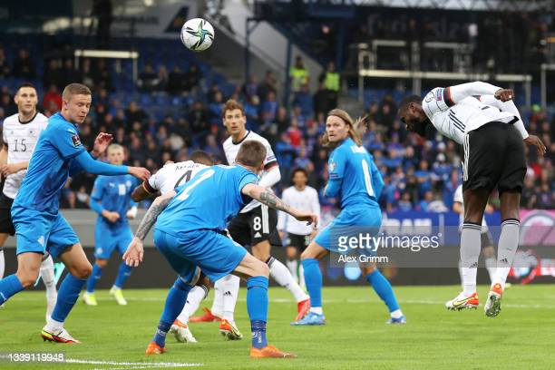 Antonio Ruediger of Germany scores their side's second goal during the 2022 FIFA World Cup Qualifier match between Iceland and Germany at...