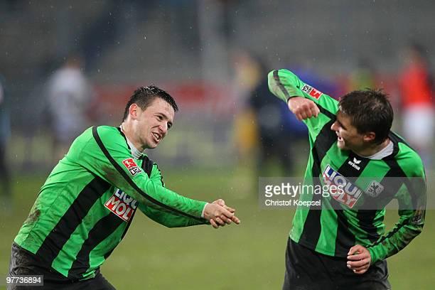 Antonio Rukavina of Muenchen and Aleksandar Ignjovski celebrates the 10 victory after the second Bundesliga match between MSV Duisburg and 1860...