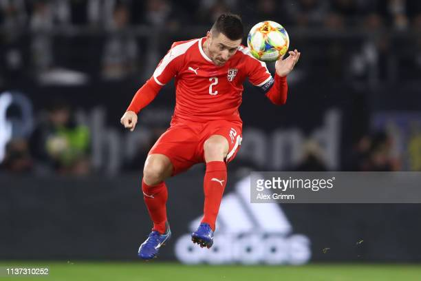Antonio Rukavina of Serbia jumps for a header during the International Friendly match between Germany and Serbia at Volkswagen Arena on March 20 2019...