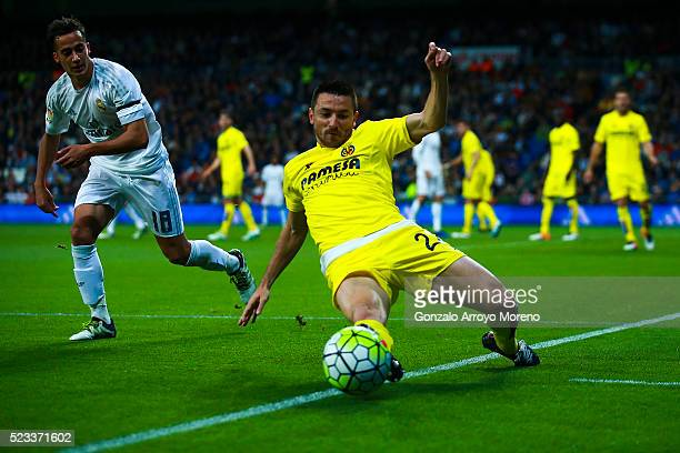 Antonio Rukavina of Villarreal CF competes for the ball with Lucas Vazquez during the La Liga match between Real Madrid CF and Villarreal CF at...