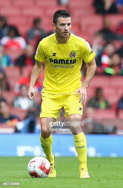 Antonio Rukavina of Villarreal runs with the ball during the Emirates Cup match between Olympique Lyonnais and Villarreal at the Emirates Stadium on...