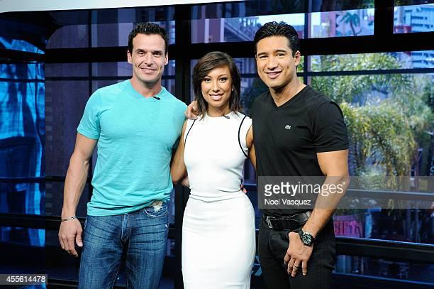 Antonio Sabato Jr Cheryl Burke and Mario Lopez visit 'Extra' at Universal Studios Hollywood on September 17 2014 in Universal City California