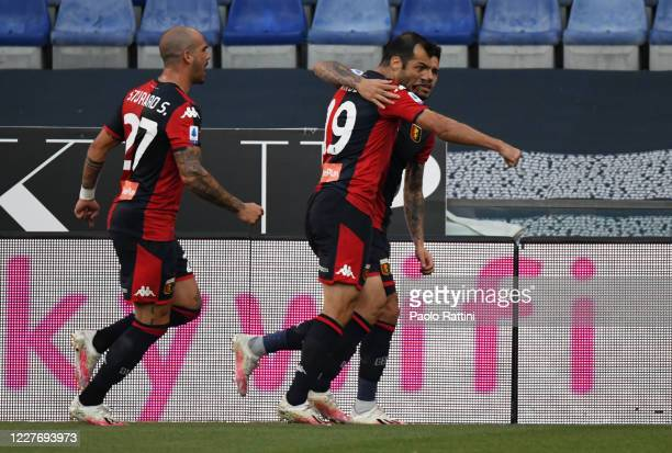 Antonio Sanabria of Genoa CFC celebrate with his teammate Goran Pandev after scoring the first goal during the Serie A match between Genoa CFC and US...