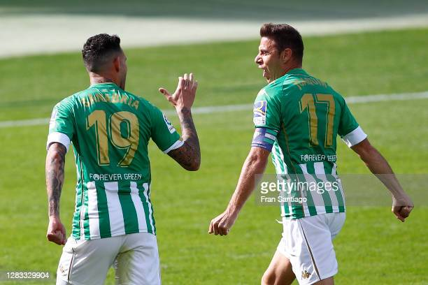 Antonio Sanabria of Real Betis celebrates with teammate Joaquin after scoring his team's first goal during the La Liga Santander match between Real...