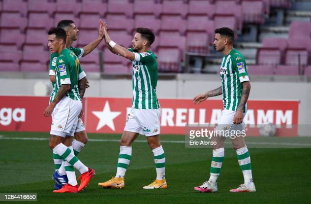 Antonio Sanabria of Real Betis celebrates with teammates after scoring his team's first goal during the La Liga Santander match between FC Barcelona...