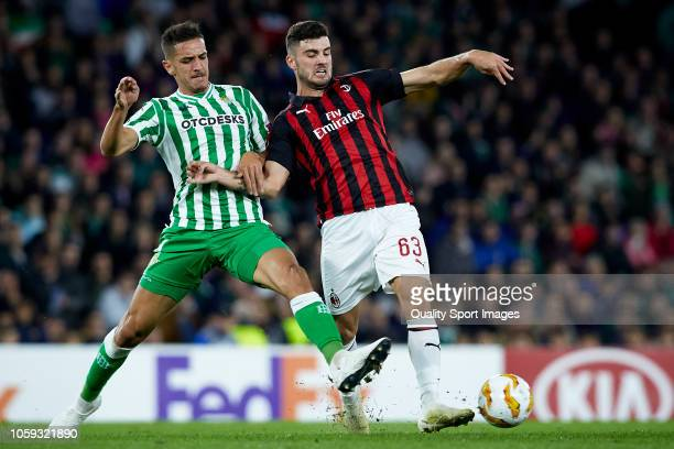 Antonio Sanabria of Real Betis competes for the ball with Patrick Cutrone of AC Milan during the UEFA Europa League Group F match between Real Betis...