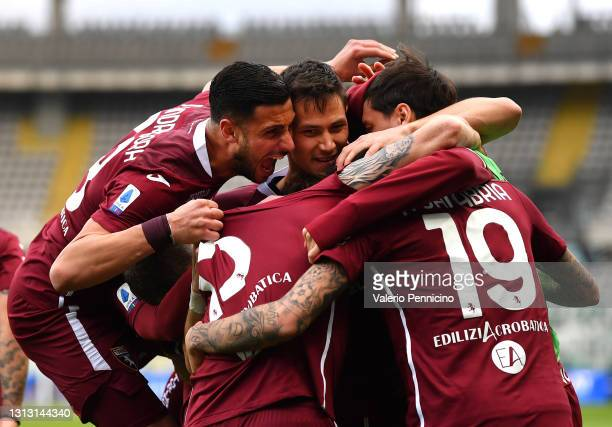 Antonio Sanabria of Torino FC celebrates with teammates after scoring his team's first goal during the Serie A match between Torino FC and AS Roma at...