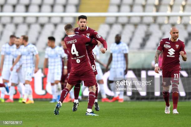Antonio Sanabria of Torino FC celebrates with Vojnovic Lyanco after scoring their side's first goal during the Serie A match between Torino FC and FC...