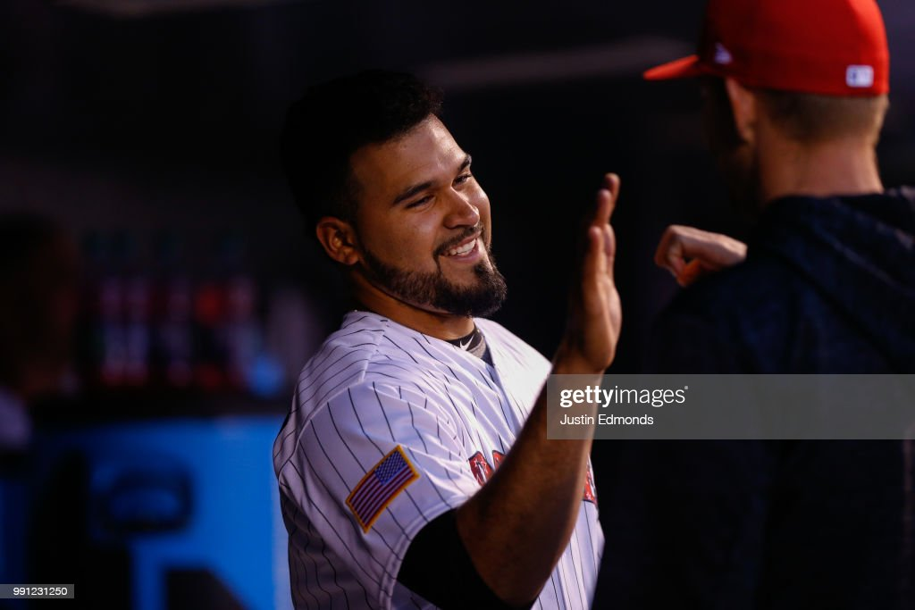 Antonio Senzatela #49 of the Colorado Rockies is congratulated in the dugout after throwing seven scoreless innings against the San Francisco Giants at Coors Field on July 3, 2018 in Denver, Colorado.