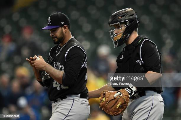 Antonio Senzatela of the Colorado Rockies speaks with Dustin Garneau during the first inning of a game against the Milwaukee Brewers at Miller Park...