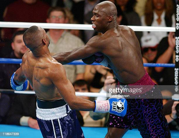 Antonio Tarver hits Roy Jones Jr with a body shot during their WBC Light Heavyweight Title bout. Jones won on a split desicison Claim The WBC Light...
