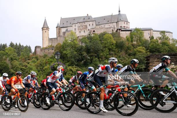 Antonio Tiberi of Italy and Team Trek - Segafredo, Tanel Kangert of Estonia and Team BikeExchange and The Peloton passing in front of the Vianden...