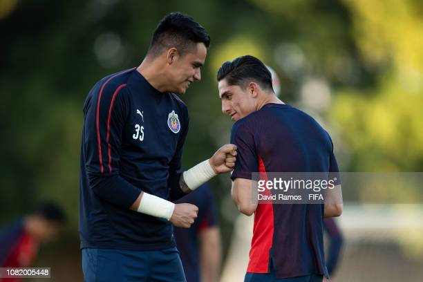 Antonio Torres and Alan Cervantes of CD Guadalajara share a joke during a training session at Special Needs Center on December 13, 2018 in Al Ain,...