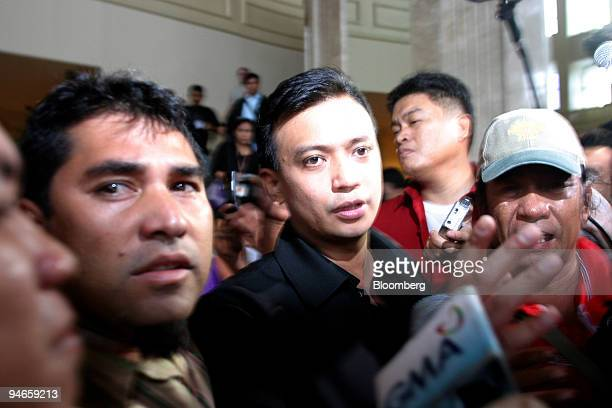 Antonio Trillanes center a Philippine senator who called for the overthrow of President Gloria Arroyo walks from the Manila Peninsula Hotel in Makati...
