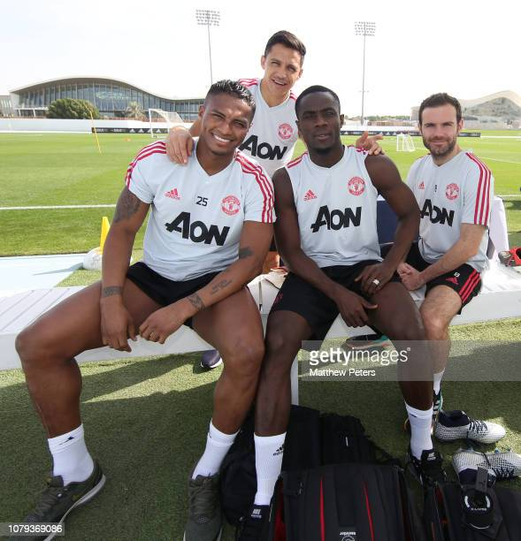 Antonio Valencia Alexis Sanchez Eric Bailly and Juan Mata of Manchester United in action during a first team training session at Nad Al Sheba Sports...