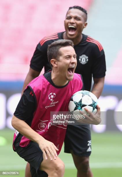 Antonio Valencia and Ander Herrera of Manchester United in action during a training session ahead of their UEFA Champions League match against...