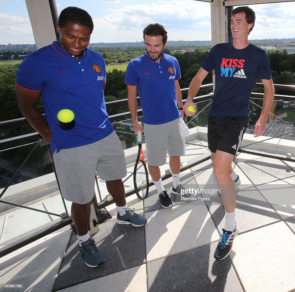 (MINIMUM PRINT/BROADCAST FEE OF GBP 150, ONLINE FEE OF GBP 75 PER IMAGE, OR LOCAL EQUIVALENT) Antonio Valencia and Juan Mata of Manchester United meet tennis player Jamie Murray who is playing in the Citi Open, at their hotel on July 28, 2014 in Washington, DC.