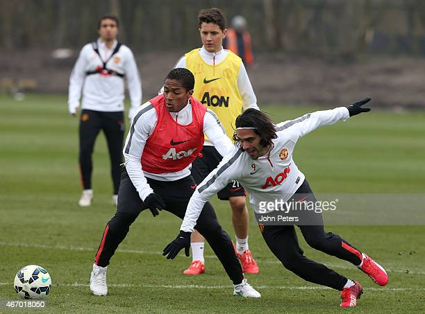 Antonio Valencia and Radamel Falcao of Manchester United in action during a first team training session at Aon Training Complex on March 20 2015 in...
