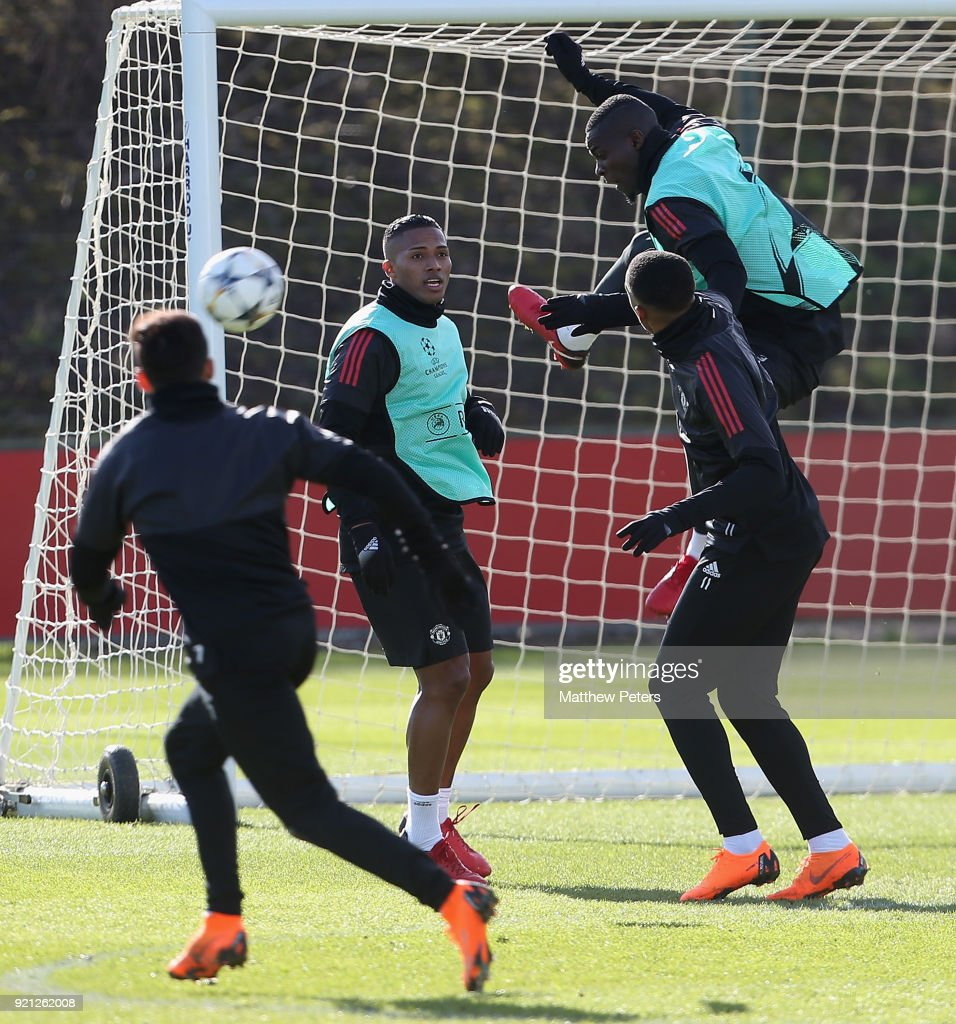 Antonio Valencia, Anthony Martial and Eric Bailly of Manchester United in action during a first team training session at Aon Training Complex on February 20, 2018 in Manchester, England.