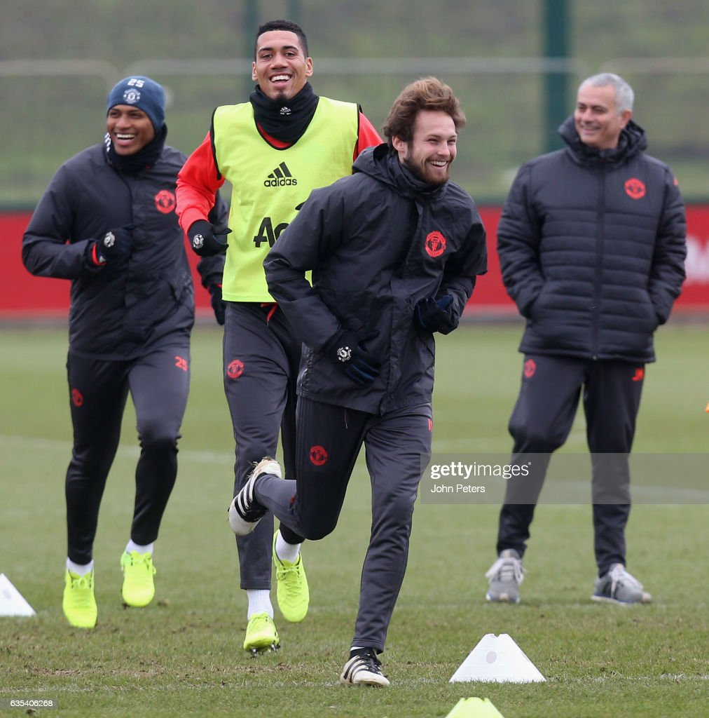 Antonio Valencia, Chris Smalling and Daley Blind of Manchester United in action during a first team training session at Aon Training Complex on February 15, 2017 in Manchester, England.