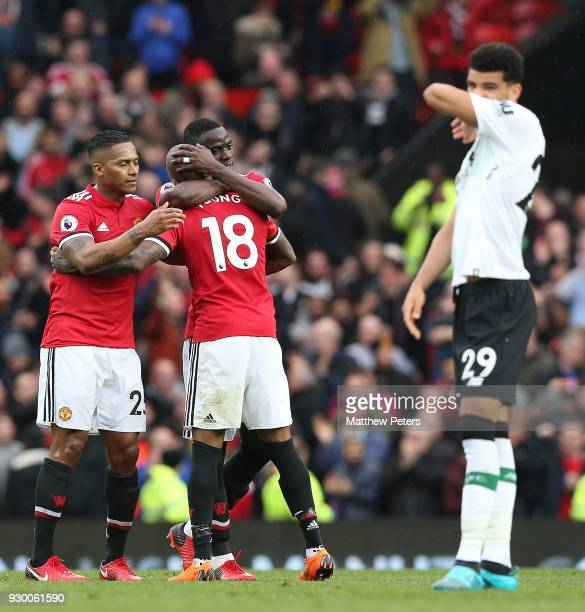 Antonio Valencia Eric Bailly and Ashley Young of Manchester United celebrate after the Premier League match between Manchester United and Liverpool...