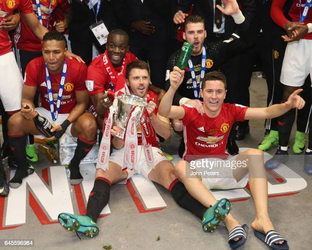 Antonio Valencia Eric Bailly Michael Carrick and Ander Herrera of Manchester United celebrate in the dressing room after the EFL Cup Final match...