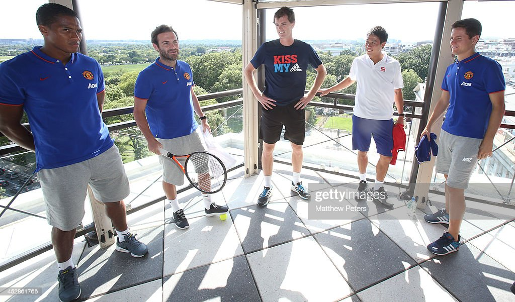(MINIMUM PRINT/BROADCAST FEE OF GBP 150, ONLINE FEE OF GBP 75 PER IMAGE, OR LOCAL EQUIVALENT) Antonio Valencia, Juan Mata and Ander Herrera of Manchester United meet tennis players Kei Nishikori and Jamie Murray who are playing in the Citi Open, at their hotel on July 28, 2014 in Washington, DC.