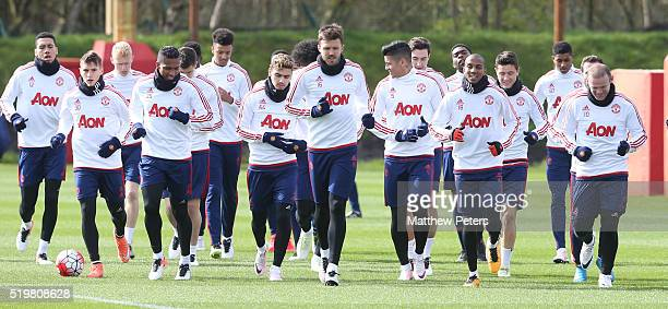Antonio Valencia Michael Carrick Ashley Young and Wayne Rooney of Manchester United in action during a first team training session at Aon Training...