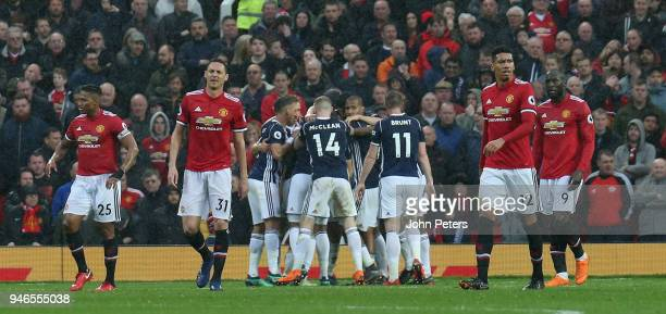 Antonio Valencia Nemanja Matic Chris Smalling and Romelu Lukaku of Manchester United react to Jay Rodriguez of West Bromwich Albion scoring their...