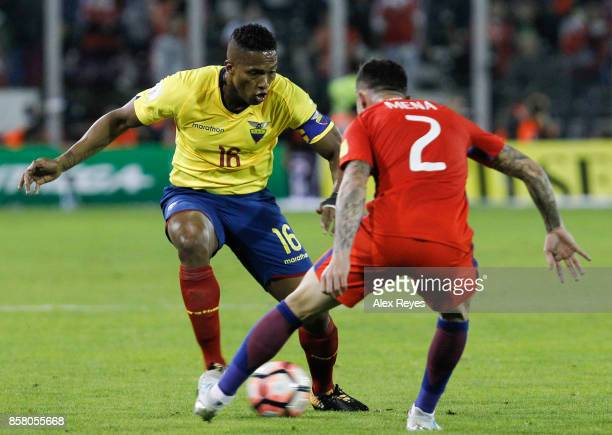 Antonio Valencia of Ecuador fights for the ball with Eugenio Mena of Chile during a match between Chile and Ecuador as part of FIFA 2018 World Cup...