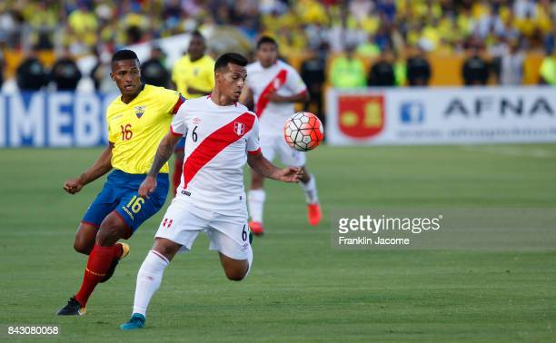 Antonio Valencia of Ecuador fights for the ball with Miguel Trauco of Peru during a match between Ecuador and Peru as part of FIFA 2018 World Cup...