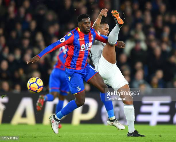 Antonio Valencia of Manchester United and Jeffrey Schlupp of Crystal Palace during the Premier League match between Crystal Palace and Manchester...