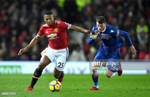 Antonio Valencia of Manchester United and Josh Tymon of Stoke City in action during the Premier League match between Manchester United and Stoke City...