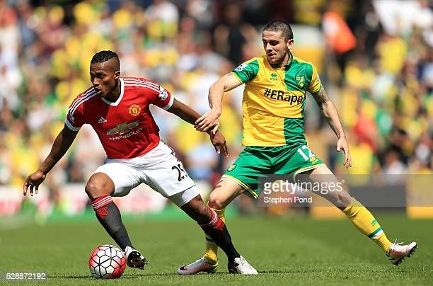 Antonio Valencia of Manchester United and Robbie Brady of Norwich City compete for the ball during the Barclays Premier League match between Norwich...