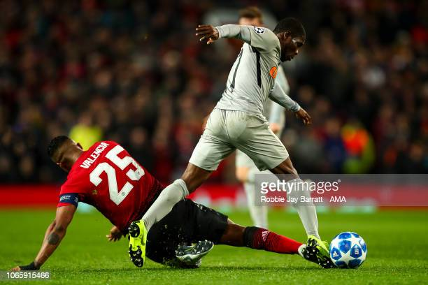 Antonio Valencia of Manchester United and Roger Assale of BSC Young Boys during the Group H match of the UEFA Champions League between Manchester...