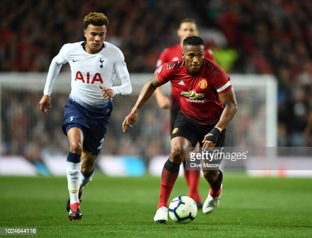 Antonio Valencia of Manchester United battles for possession with Dele Alli of Tottenham Hotspur during the Premier League match between Manchester...