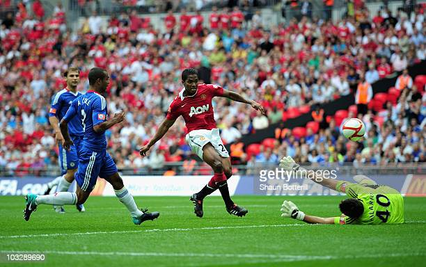 Antonio Valencia of Manchester United beats Henrique Hilario of Chelsea to score their first goal during the FA Community Shield match between...