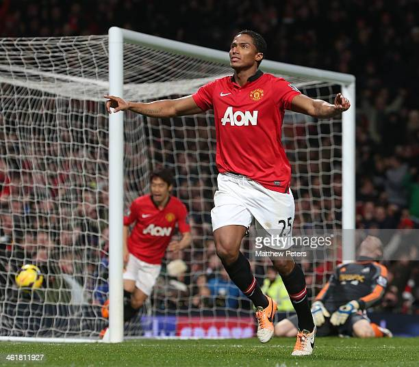 Antonio Valencia of Manchester United ceebrates scoring their first goal during the Barclays Premier League match between Manchester United and...